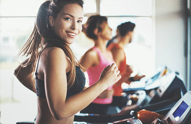treadmill workout. - health club stock photos and pictures