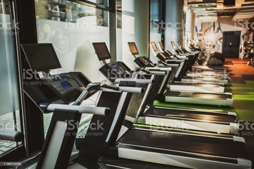 Group of running tracks in a gym without people.