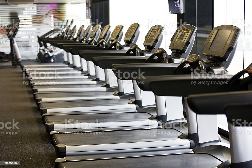 treadmills in gym stock photo
