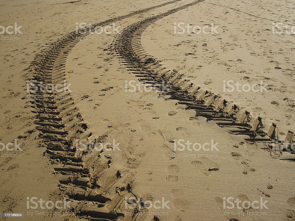 treads tire over beach sand royalty-free stock photo