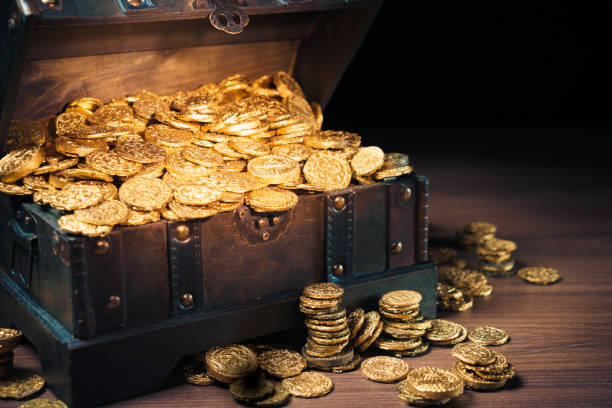 treasure chest filled with gold coins - coin stock photos and pictures