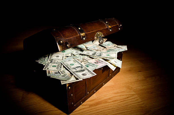 A treasure chest filled with money stock photo