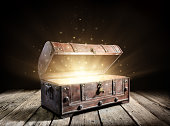 istock Treasure Chest - Open Ancient Trunk With Glowing Magic Lights In The Dark 1160778039