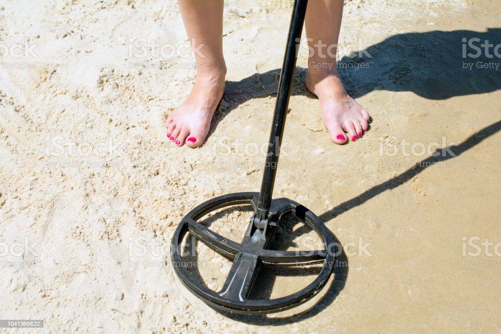 metal detector treasure hunt in the sand
