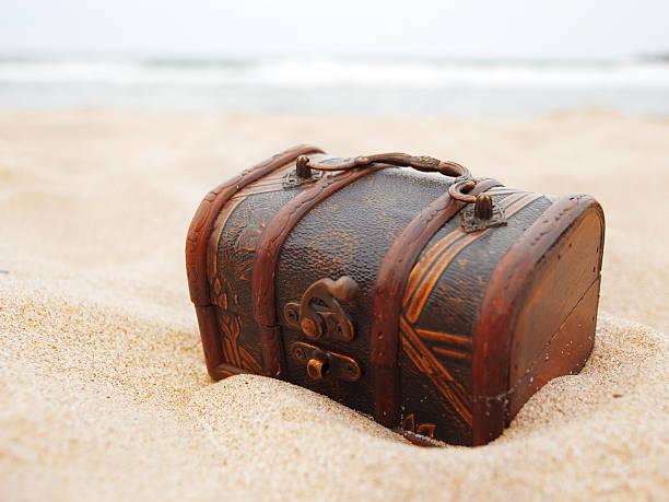 Treasure in den sand – Foto