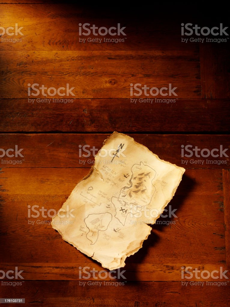 Treasure Map on a Wooden Table royalty-free stock photo