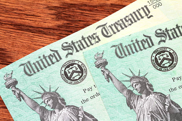 usa treasury checks - social security check stock photos and pictures