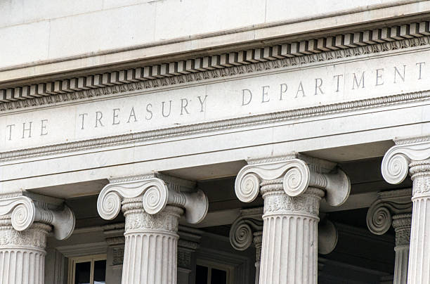 US treasury department sign in Washington DC facade US treasury department sign in Washington dc building facade federal building stock pictures, royalty-free photos & images