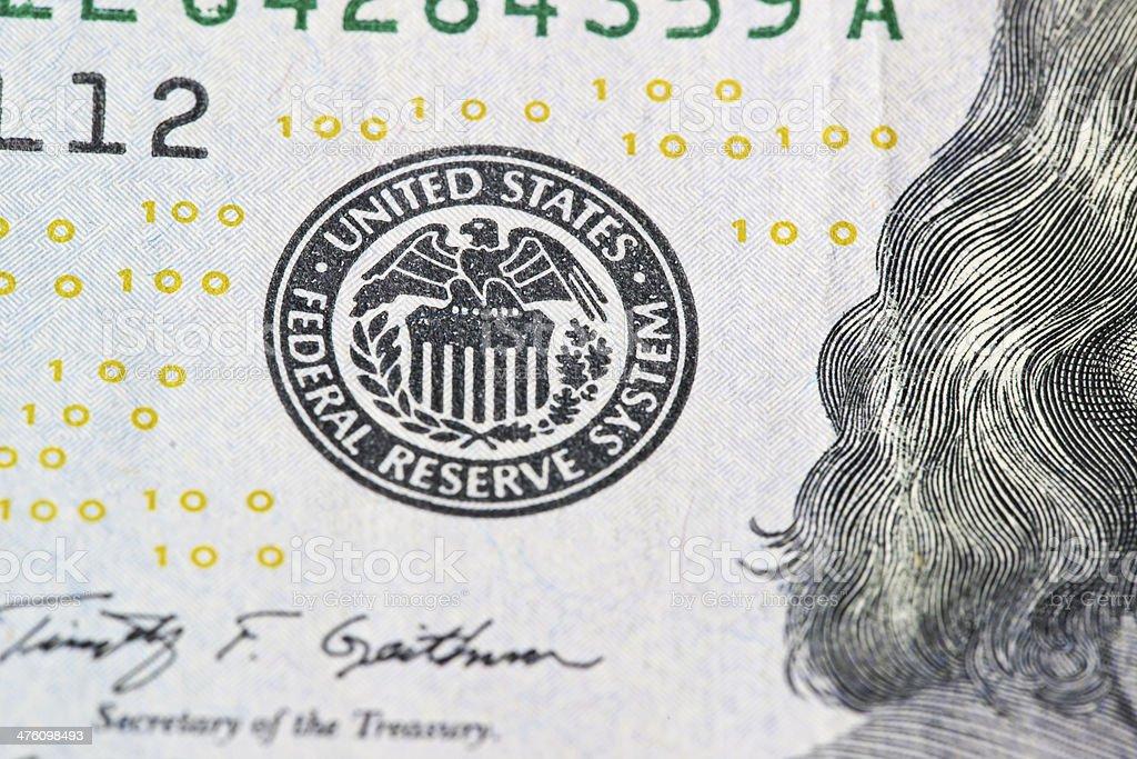 US Treasury Stamp On 100 Dollar Bill