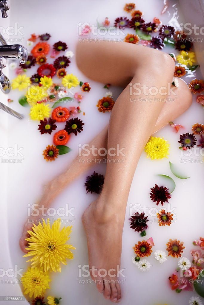 Treat yourself to a luxurious homemade milk bath stock photo