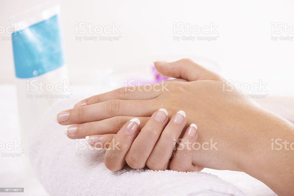 Treating her hands royalty-free stock photo