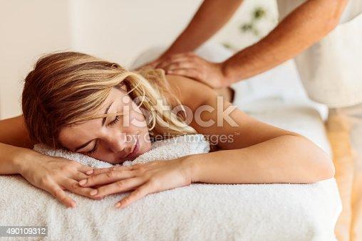 525211834 istock photo Treating her skin 490109312