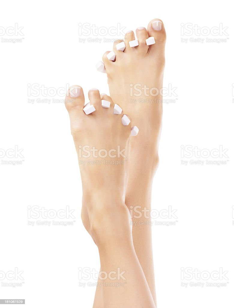 Treating herself to a pedicure royalty-free stock photo