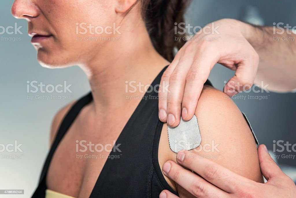 TENS treatment in physical therapy stock photo