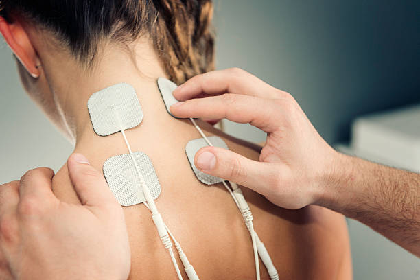 TENS treatment TENS treatment in physical therapy alternative therapy stock pictures, royalty-free photos & images