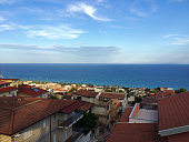 This picture shows a beautiful view of Trebisacce in Italy out of our own house. Far away is the wonderful ocean under the blue sky.