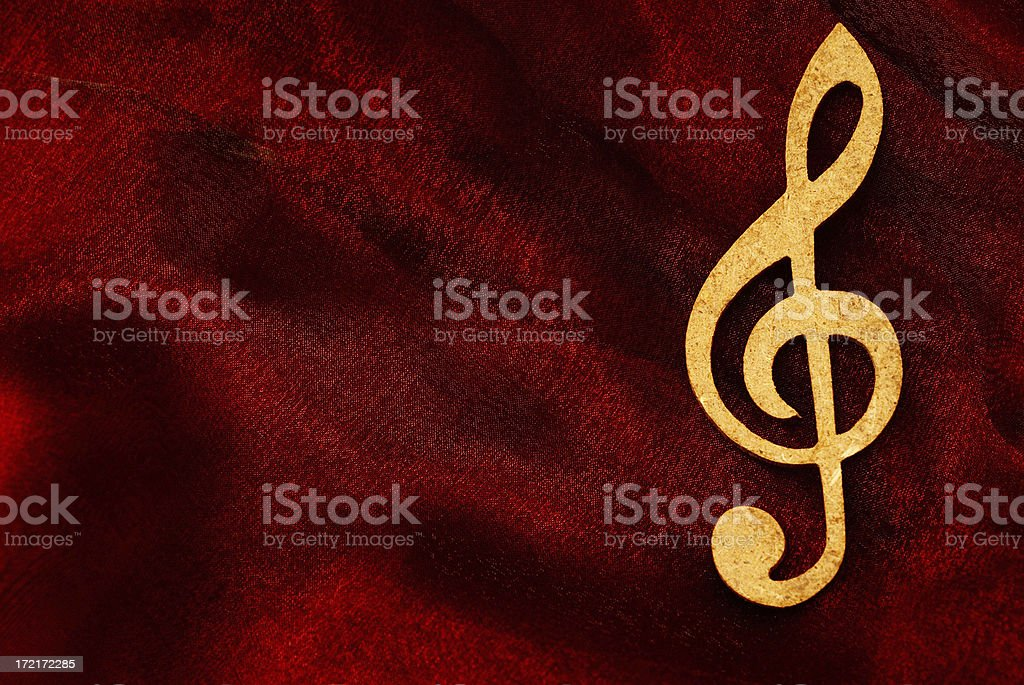 Treble Clef on the Red Velvet royalty-free stock photo