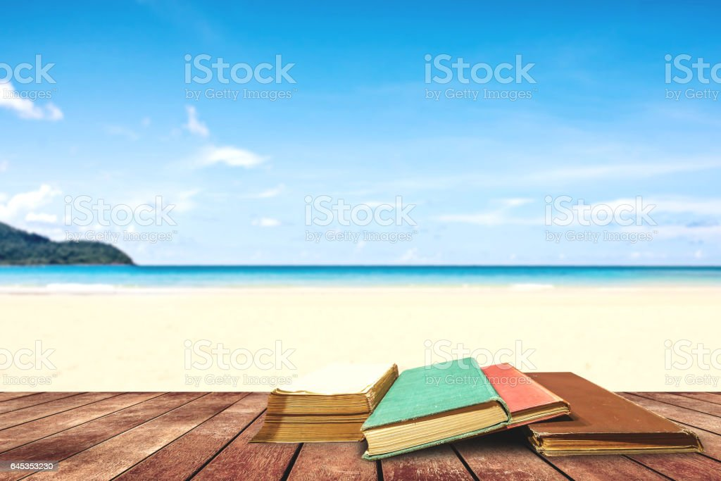 tree aged book and grunge paper on wooden platform beside tropical beach and blue sea on day noon light. - foto de acervo