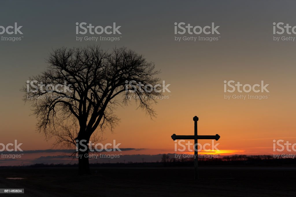 tree and a cross stock photo