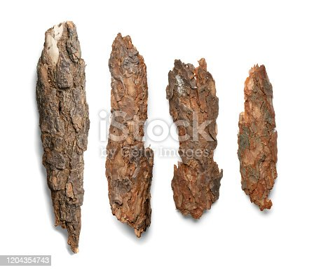 istock Tree Bark or Garden Mulch Isolated on White Background 1204354743