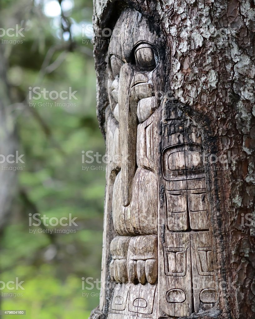 Tree carved by native Tlingit indians stock photo