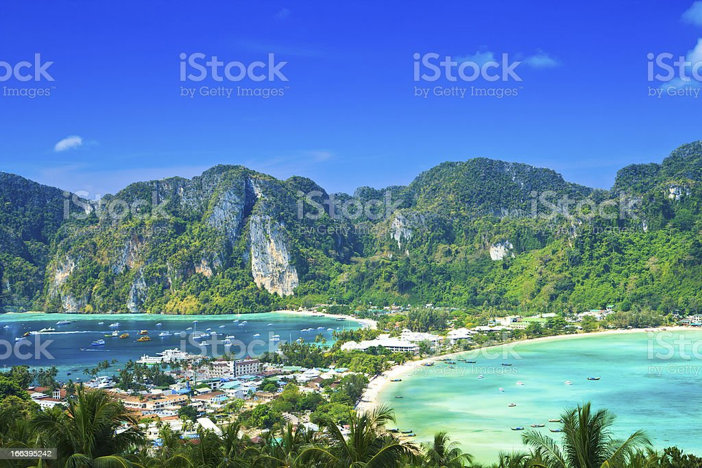 Tree covered mountains and blue oceans of Ko Phi-Phi stock photo