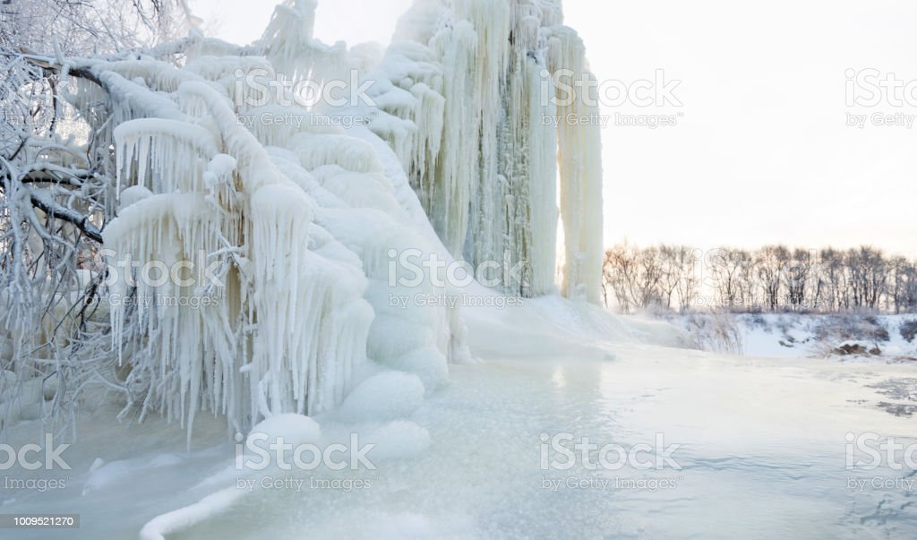 Tree covering with snow and icicle stock photo