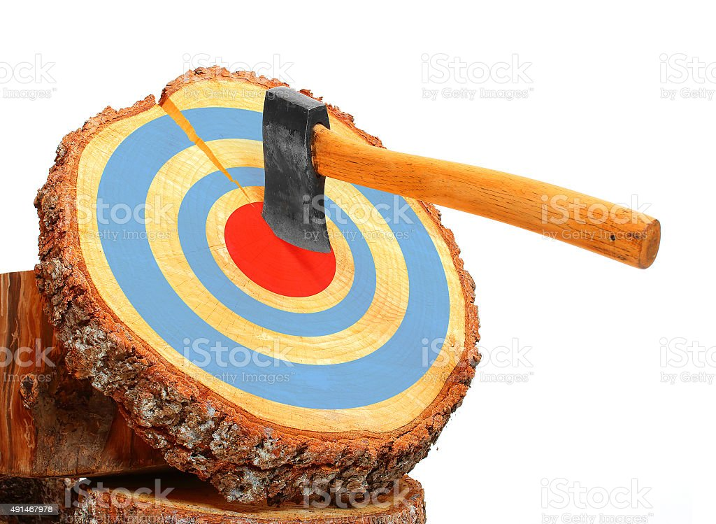 Tree cut and axe in the target. stock photo