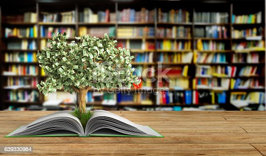 istock tree growing from book A big open book 639330984