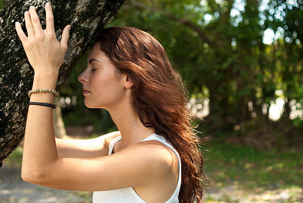 Tree hugger girl Young woman in nature tree hugging tree hugging stock pictures, royalty-free photos & images