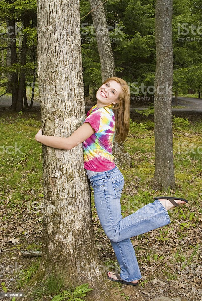 Tree Hugger With Foot Up stock photo
