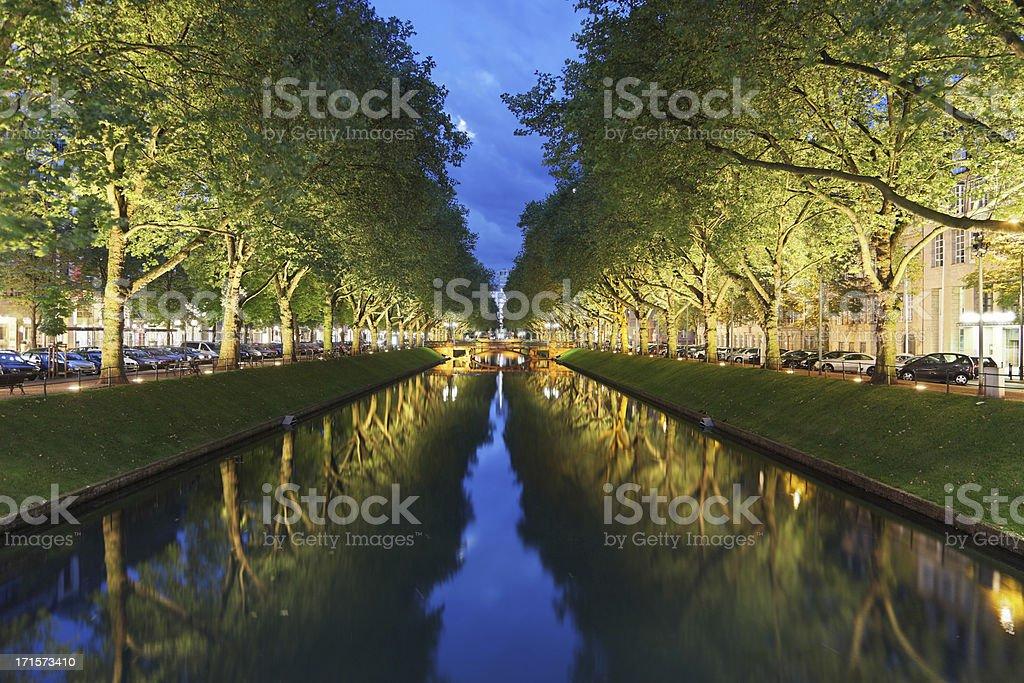 Tree lined Konigsallee in Dusseldorf in the evening stock photo