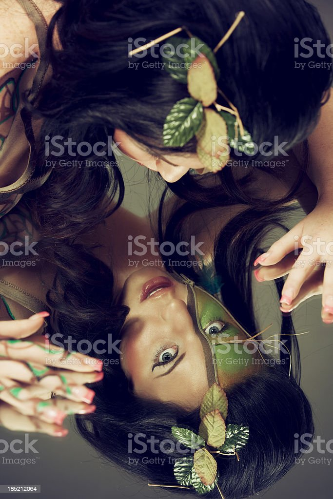 Tree nymph: reflection of a woman with green face royalty-free stock photo