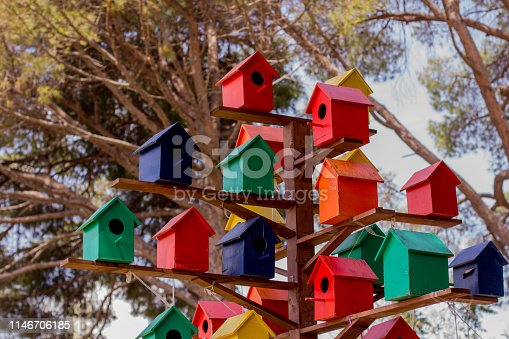 Tree of color birdhouses for birds in the park