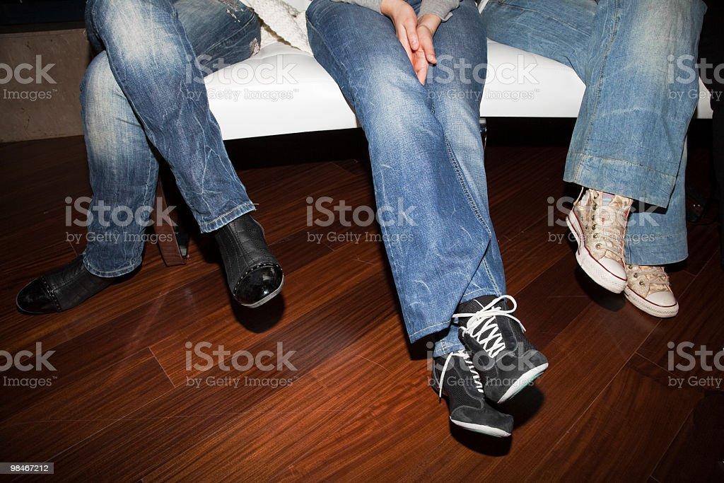 Tree Persons sitting on Sofa royalty-free stock photo