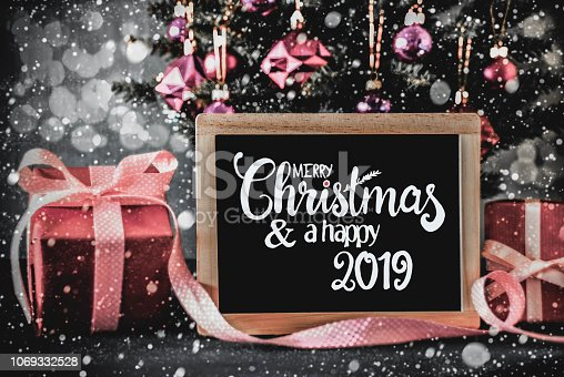 istock Tree, Presents, Calligraphy Merry Christmas And A Hapy 2019 1069332528