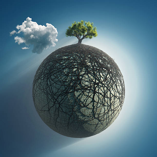 tree roots covering the planet - creation stock photos and pictures