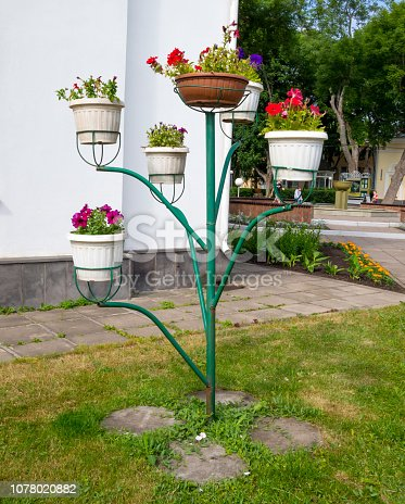 Tree shaped flower stand in the park
