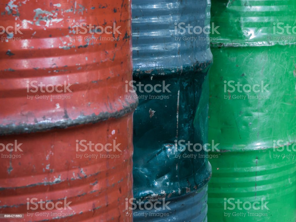 tree steel barrels in different colours stock photo