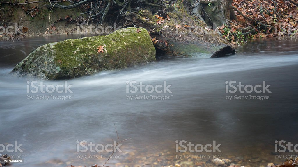 Tree Stump and Silky Stream stock photo
