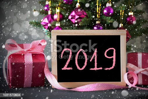 istock Tree With Gifts, Snowflakes, Bokeh, Text 2019 1031570604