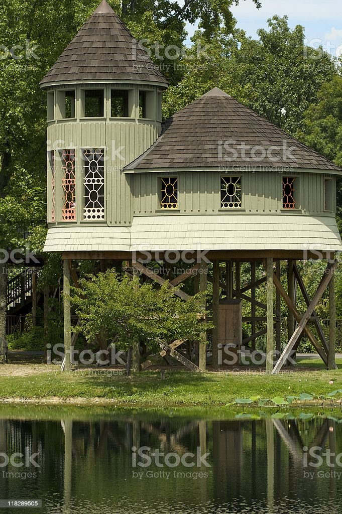 Treehouse over pond. royalty-free stock photo
