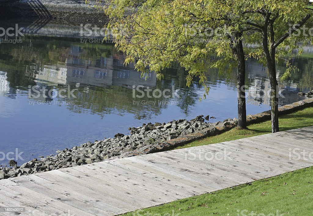 Tree-lined Boardwalk at Granville Island, Vancouver, British Columbia, Autumn royalty-free stock photo