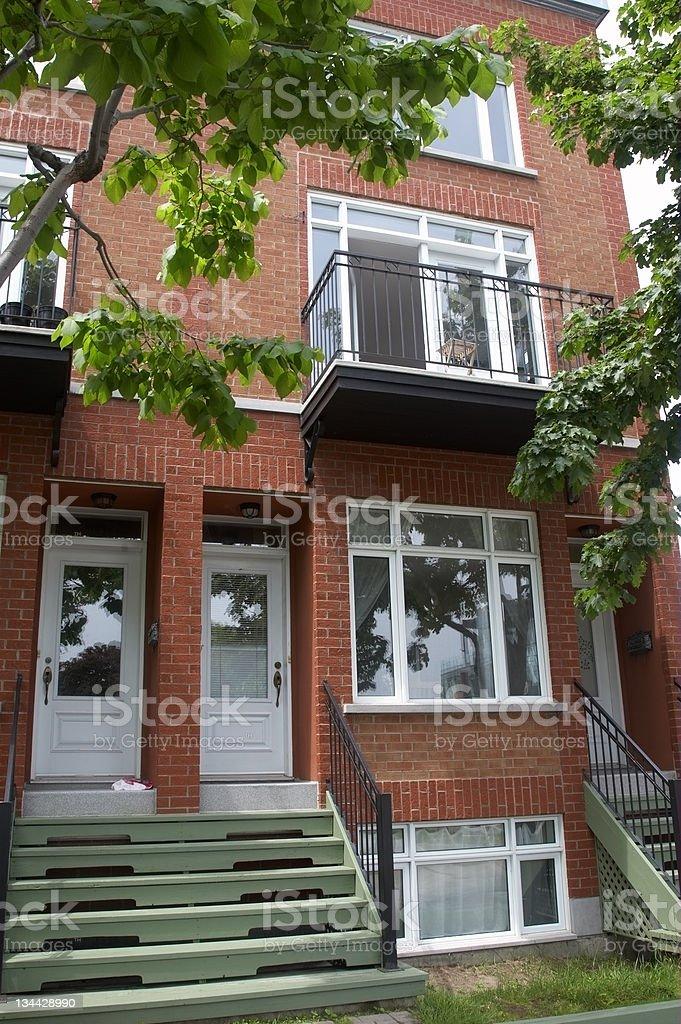 Treelined terrace houses and balcony royalty-free stock photo