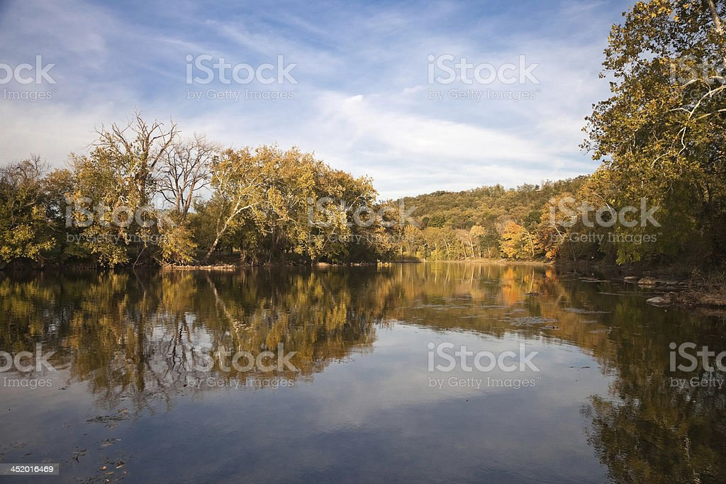 Trees reflecting in the Shenandoah River stock photo