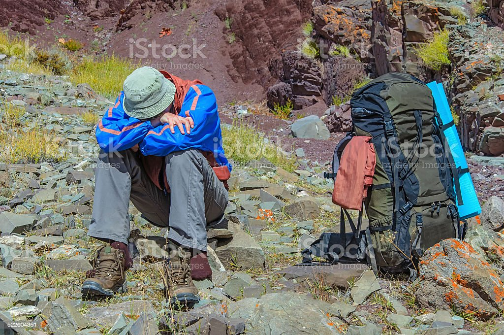Trekker resting in height mountain stock photo