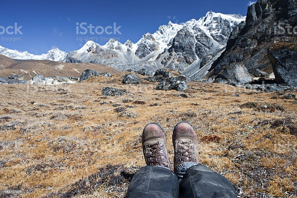 Trekker resting in Himalayas royalty-free stock photo