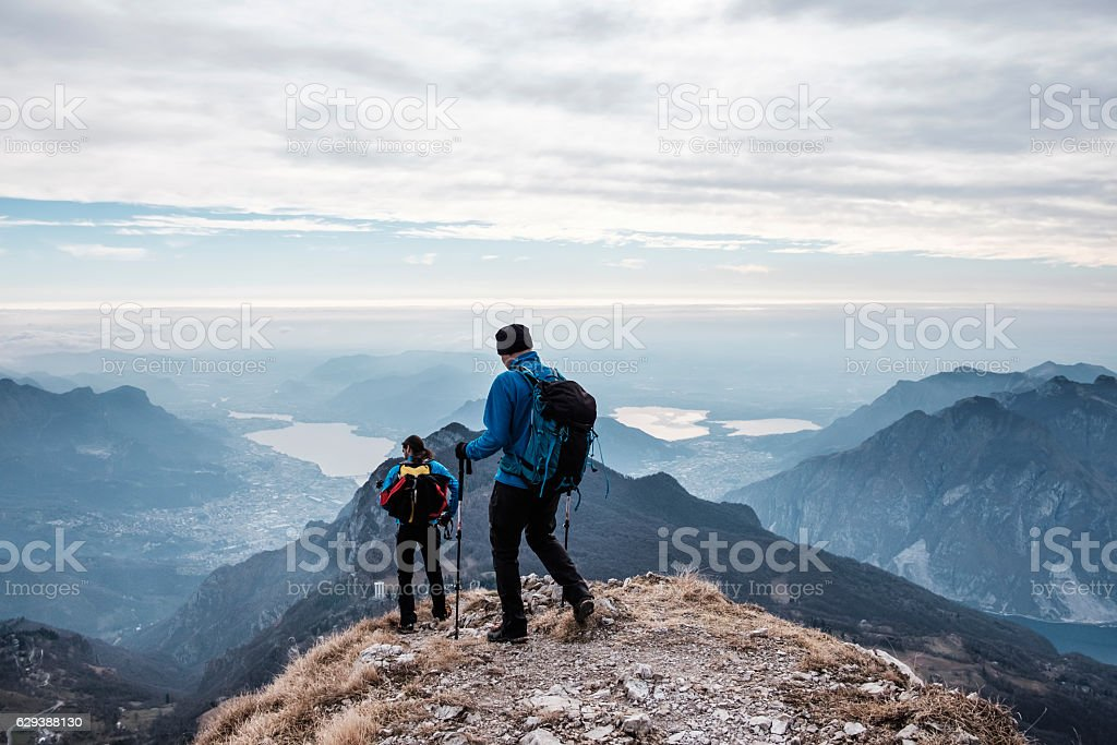 Trekkers during hiking on the mountains stock photo