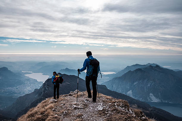 trekkers during hiking on the mountains - natural landmark stock pictures, royalty-free photos & images
