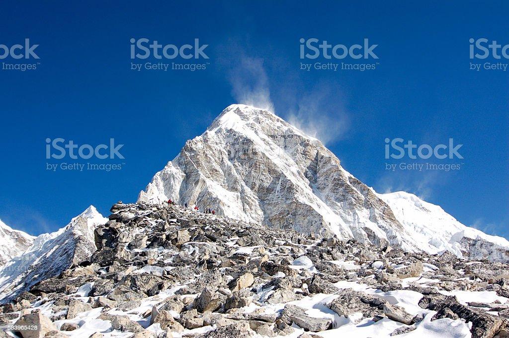 Trekkers on Kala Patthar with Pumori behind stock photo